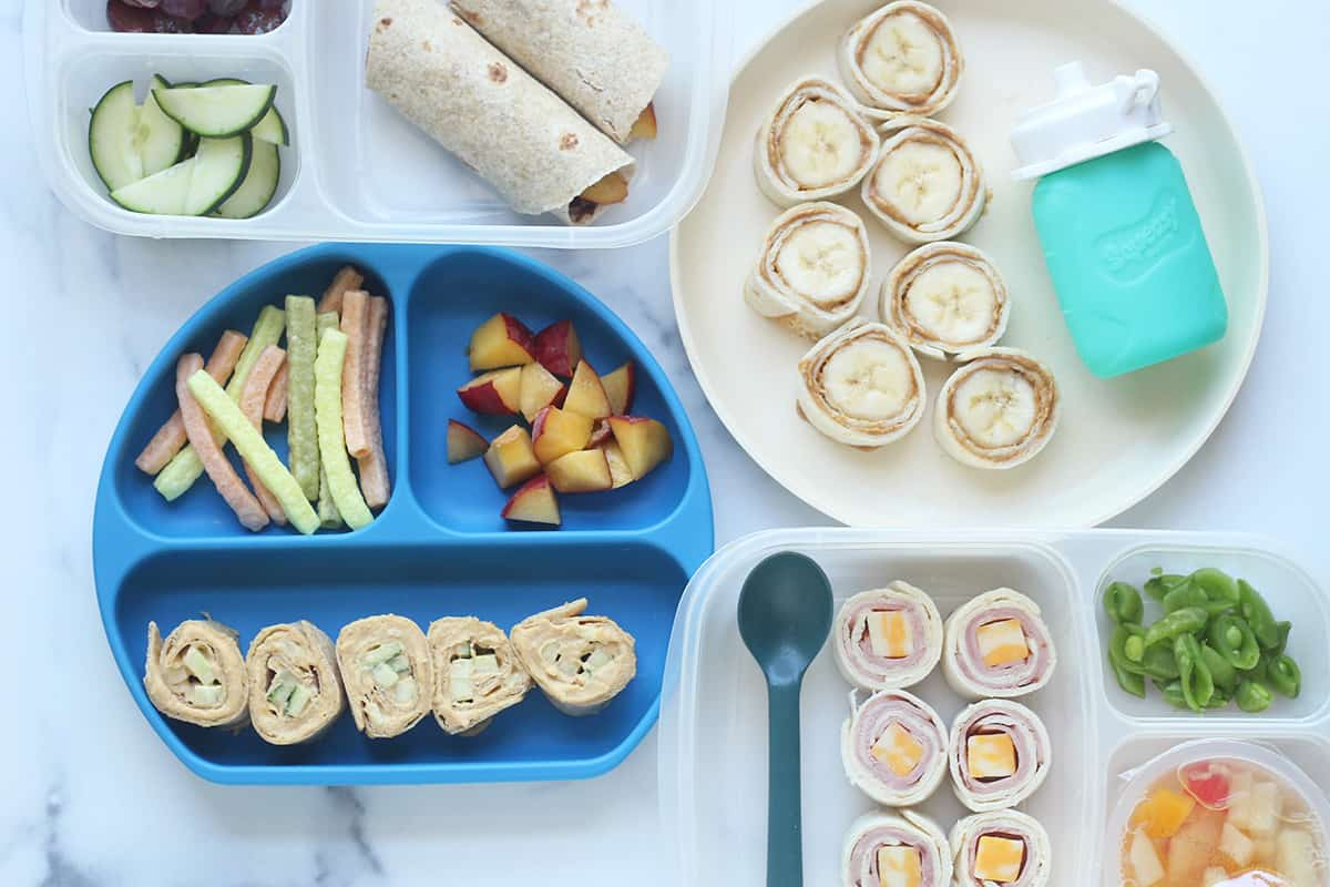 wraps for kids on plates and lunchboxes on counter