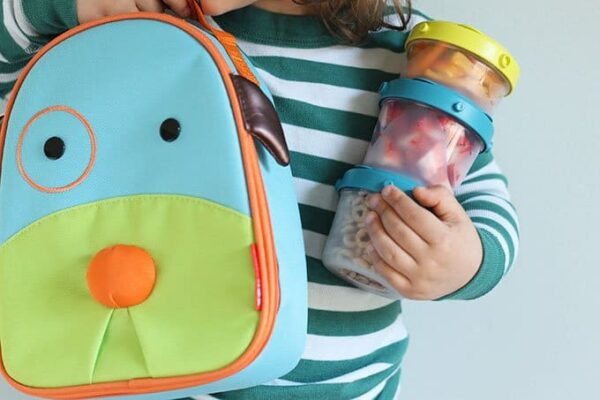 skip hop lunch bag and stack of food containers